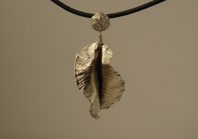 hand forged sterling silver organic flower with patina necklace