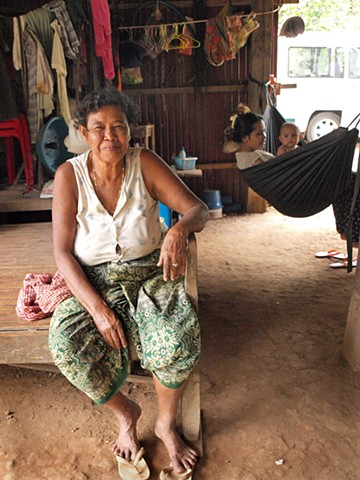 Woman in her home at mango tree village