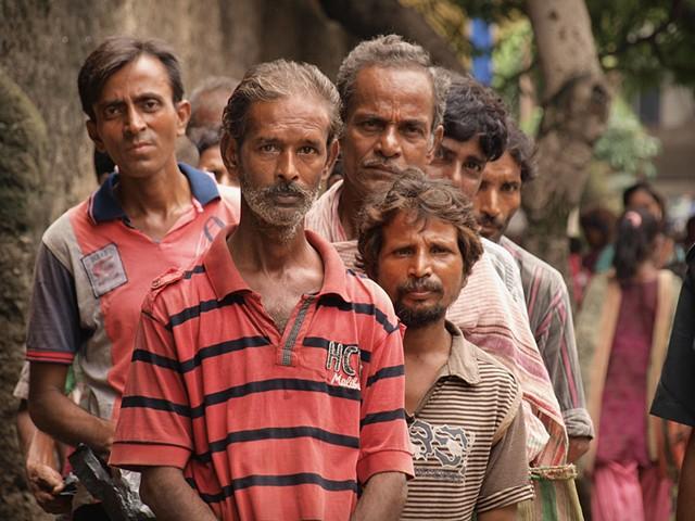 Men in a food line