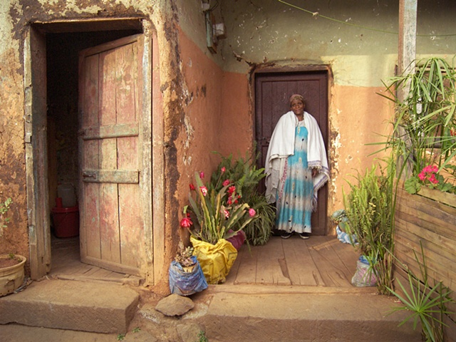 Woman in front of her home