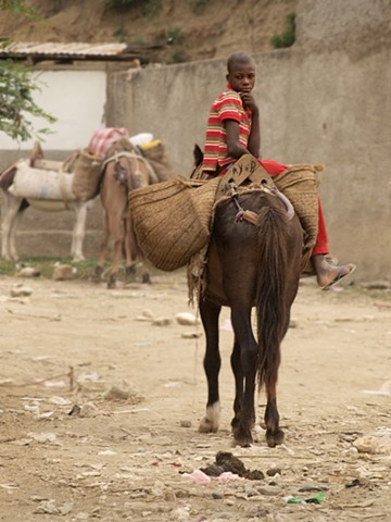 Boy on horse in marketplace