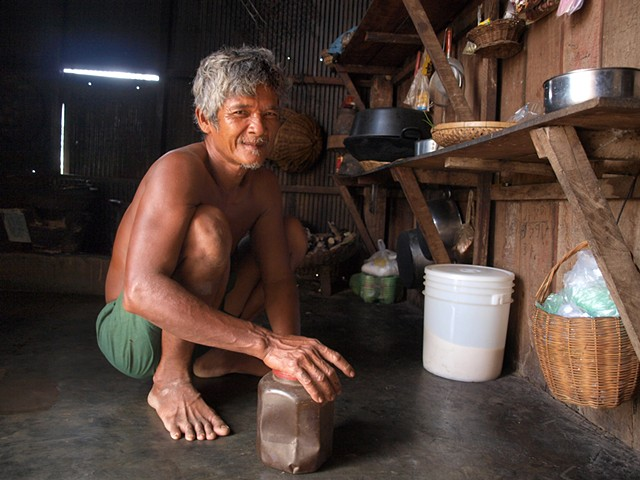 Villager in his home getting coffee