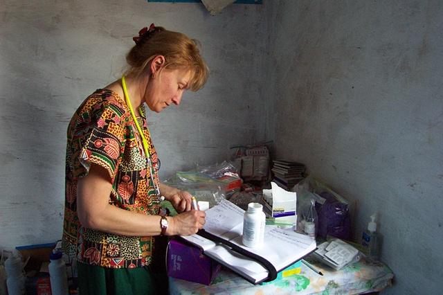 Missionary nurse making notes