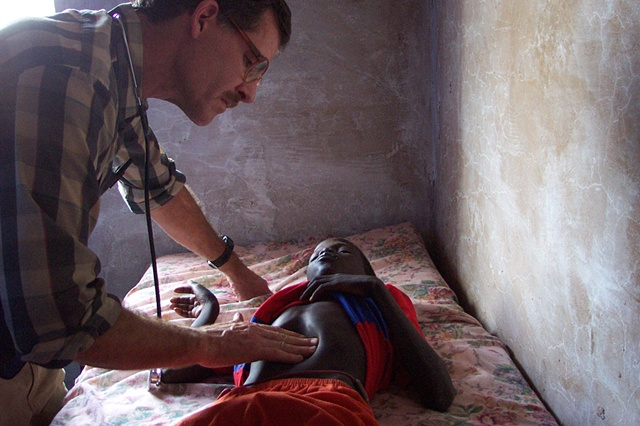 Missionary doctor examining young boy