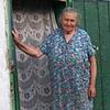 Olya in the doorway of her home