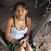 Young Kuna woman sitting on hammock Darien Jungle
