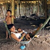 Kuna woman in hammock  with her two children Darien Jungle