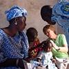 Missionary nurse examining child - Mbaakhe