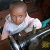 Child with sewing machine