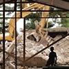 Watching his school being demolished Léogâne