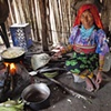 Kuna woman cooking plantains San Blas Islands