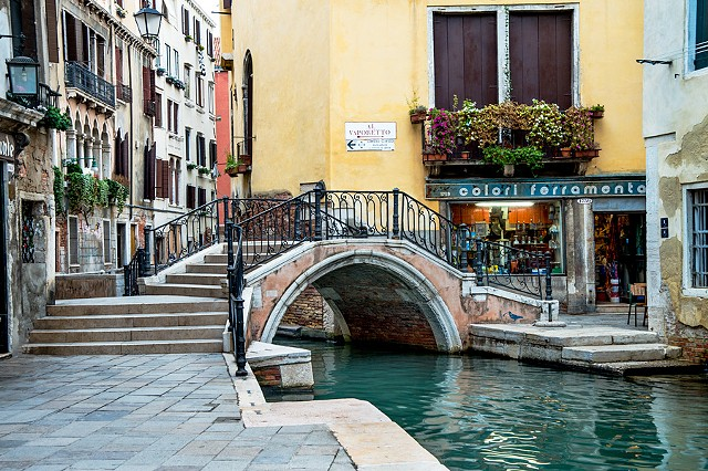 Bridge over the Canal, emerald and turquoise colored waters of Venice, tranquil reflections