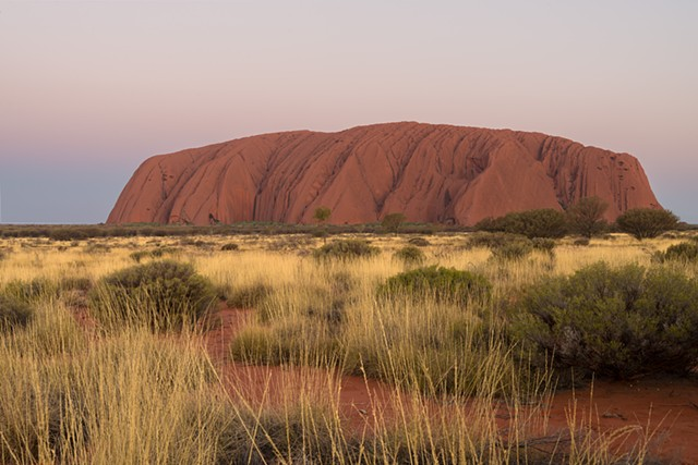 Uluru at Sunset Goes Through a Range of Colours as the Sun Sets