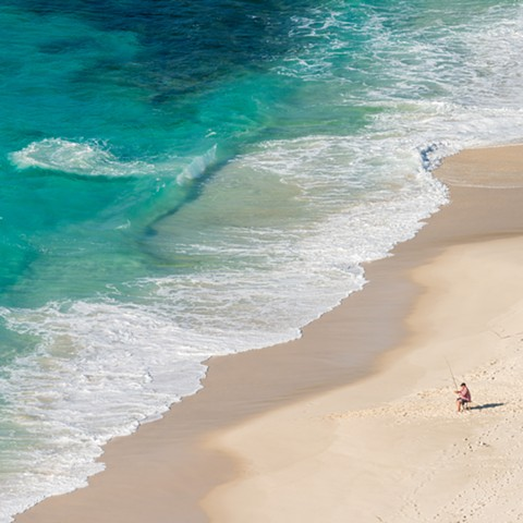 Birds Eye View of Fisherman on the Beach and Turquoise Waters