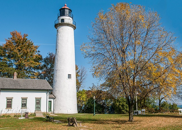 The fall colours and blue sky bring out the best in this lighthouse.