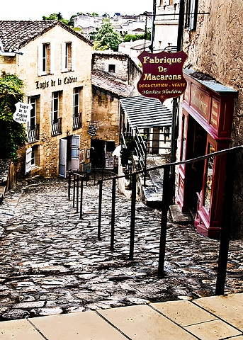 Macarons store in St Emilion France, a steep hill of cobblestone with a store half way down
