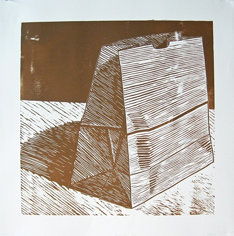 One layer woodblock print by Kristin Powers Nowlin of a brown paper bag.