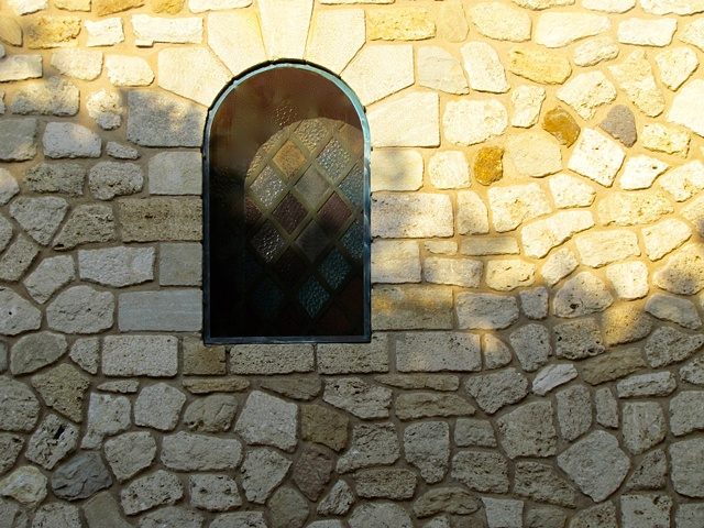 window, stained glass, leaded glass, metal frames, stone church, 12th century