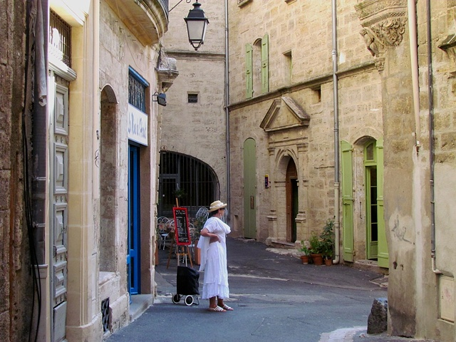 woman, white, dress, hat, shoes, shopping, Pezenas, cobblestone streets, green door, blue, door. old town