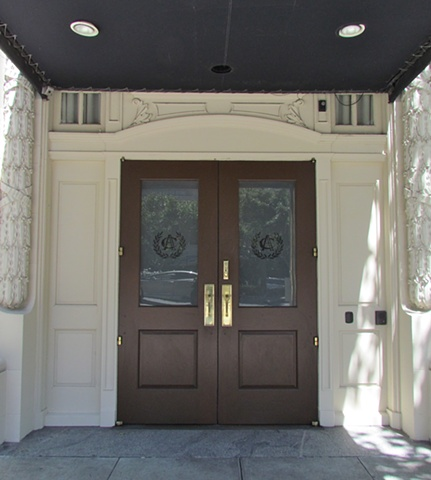 Entry doors in San Francisco, with white frame and brown doors and glazed windows.
