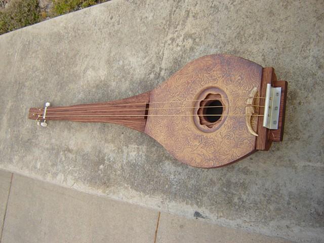 Claytar (ceramic and wood electric guitar)