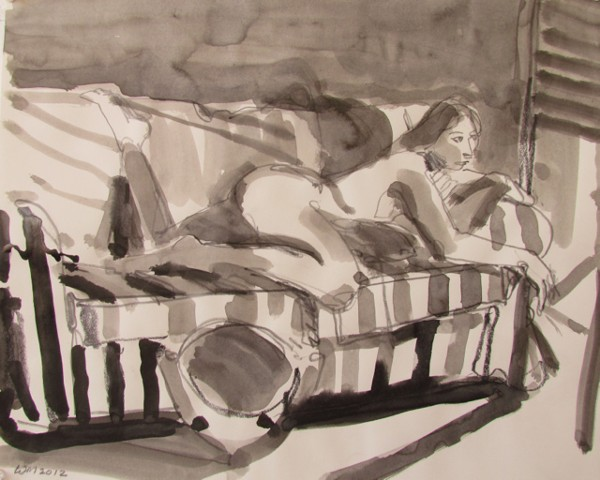 woman on stomach, striped couch, heater in foreground