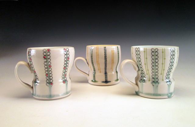 3 thrown porcelain cups with handles with underglaze and overglaze decals
