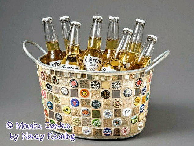 Copper bucket with a moasic of hand cut ceramic and assorted beer caps. Holds 12 beer bottles.