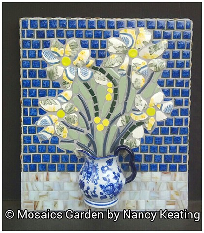 3 dimensional pique assiette style mosaic panel