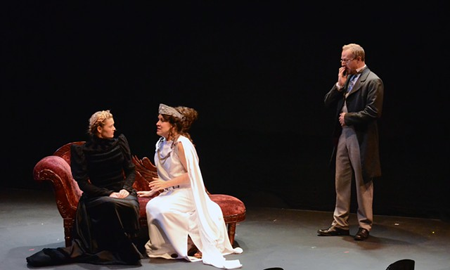 Medea tries to counsel Hedda as Tesman looks on