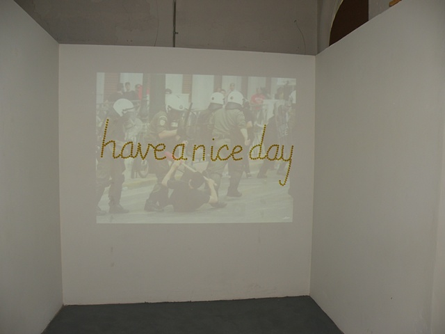 Installation of riot photos.  Have a Nice Day by Courtney Kessel