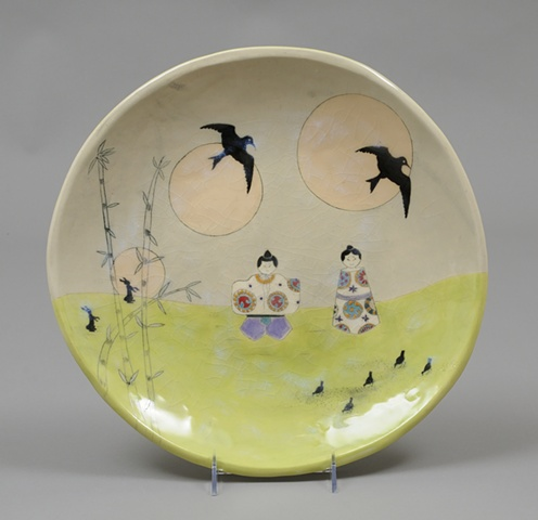 platter with 2 asian dolls