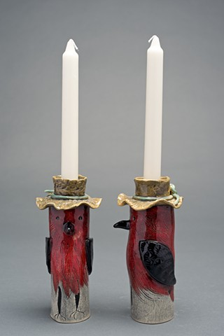 red bird candle holders with hats