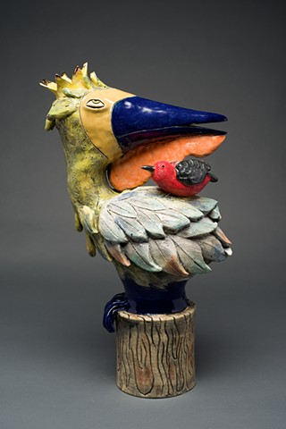 Pelican with red bird