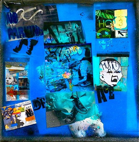 mixed media painting done with artists photos,collage, and spray paints