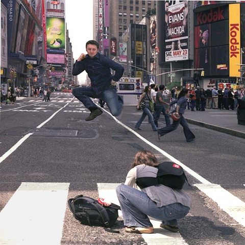 man jumping in Times Square