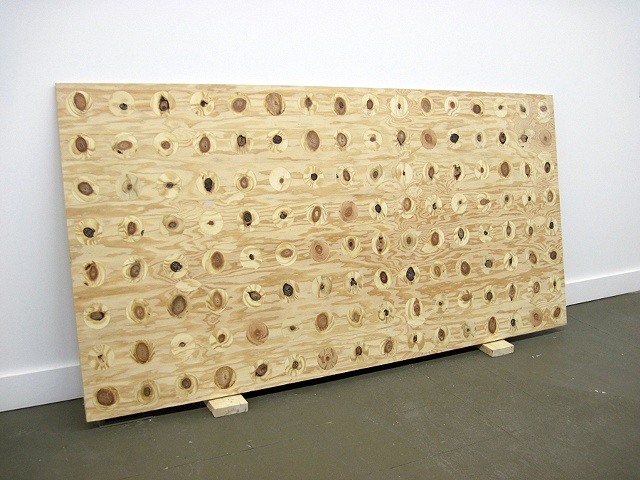 plywood sculpture with inlaid found knots