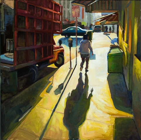 bright sunlight hitting woman walking away.  Red truck on side, yellow sidewalk.