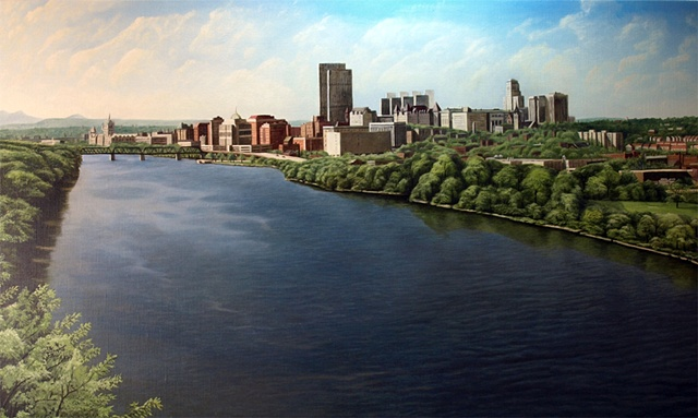 A cityscape of Albany, NY from the I-90 Bridge on the Rensselaer side of the Hudson River