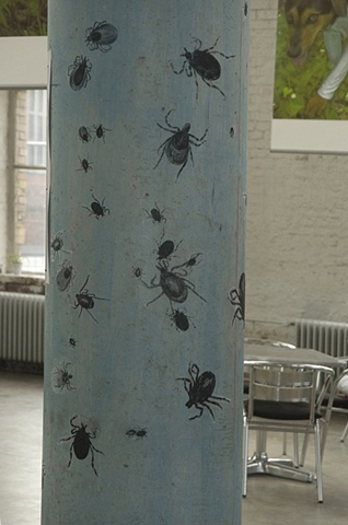 drawings of ticks attached to columns forming a part of the installation at the Printing Museum in Darmstadt, Germany