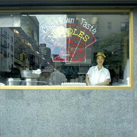 wioman making dumplings in window