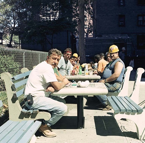 men eating at picnic table