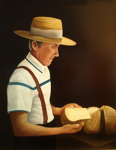 A portrait of my father cutting his favorite traditional bread