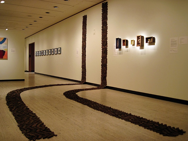 bark and soil installation of fabricated tire tracks, nature art