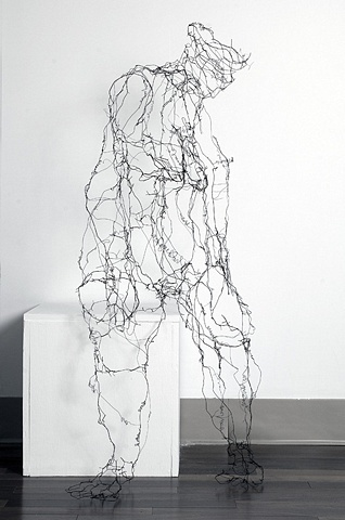 Seated figure, wire and words
