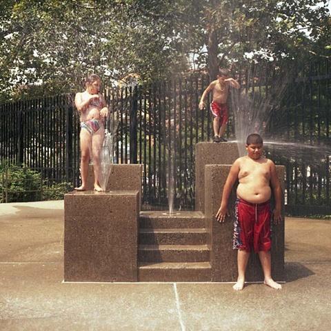 children playing in fountain
