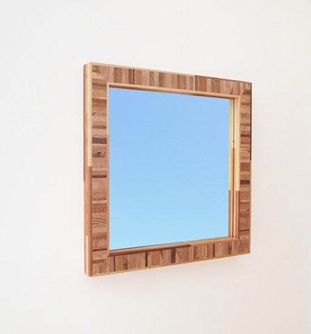 Handmade modern mirror with a multi-colored softwood frame by Andrew Traub