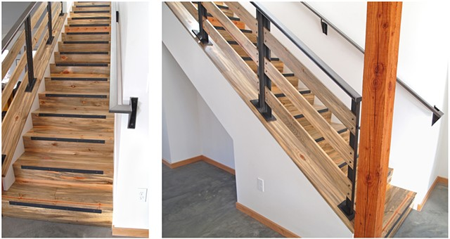 Stairs with a raw steel and blue pine railing, design and woodwork by Andrew Traub. Steel by Johnny Weld.