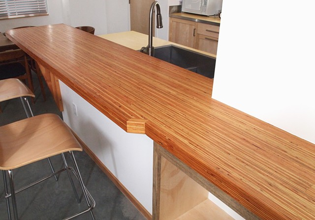 LVL wood bar counter with a rich tung oil blend finish