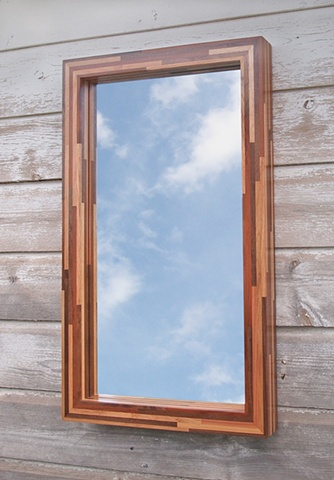 Modern wood mirror frame handmade with scrap and salvaged woods. Modern haning mirror by Andrew Traub